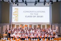 Students on stage at 2018 graduation